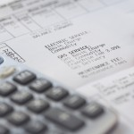 Calculator and Pencil on Invoice